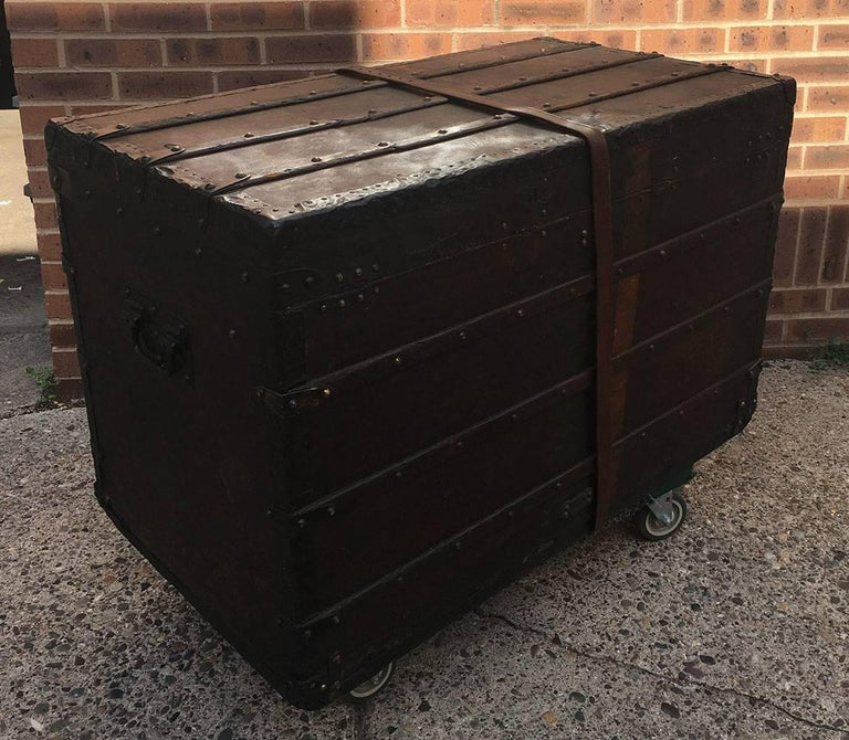 STUNNING Louis Vuitton antique monogram steamer trunk in excellent antique condition. Original signature monogram canvas exterior trimmed with wood and brass hardware. Orange and green stripe surround the outside and were originally painted to help