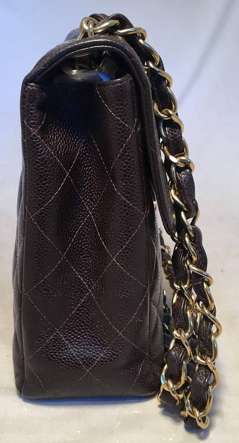 10ef20081f9a TIMELESS Chanel Dark Brown Quilted Caviar Maxi Classic Flap Shoulder Bag in  excellent condition. Dark