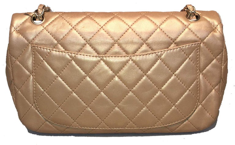 AMAZING Chanel gold leather gem logo closure classic flap shoulder bag in excellent condition. Quilted soft gold leather exterior trimmed with matte gold hardware, woven chain and leather doubled shoulder strap and gorgeous gem embellished front