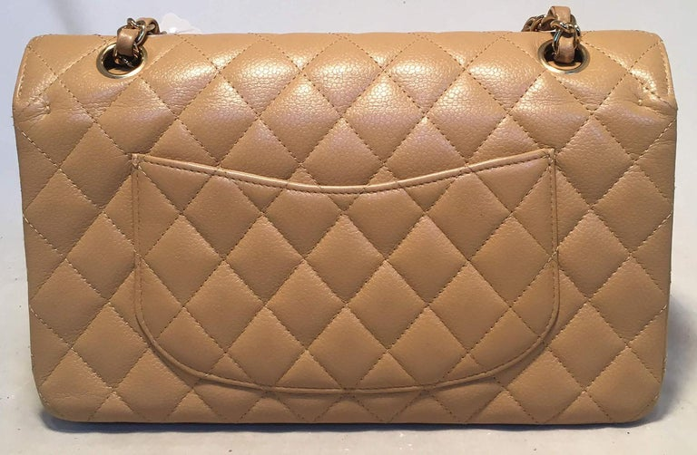 Beautiful Chanel tan caviar 10inch 2.55 double flap classic in excellent condition. Tan caviar leather exterior trimmed with gold hardware and woven chain and leather shoulder strap. Front CC logo twist closure opens to a tan leather interior that