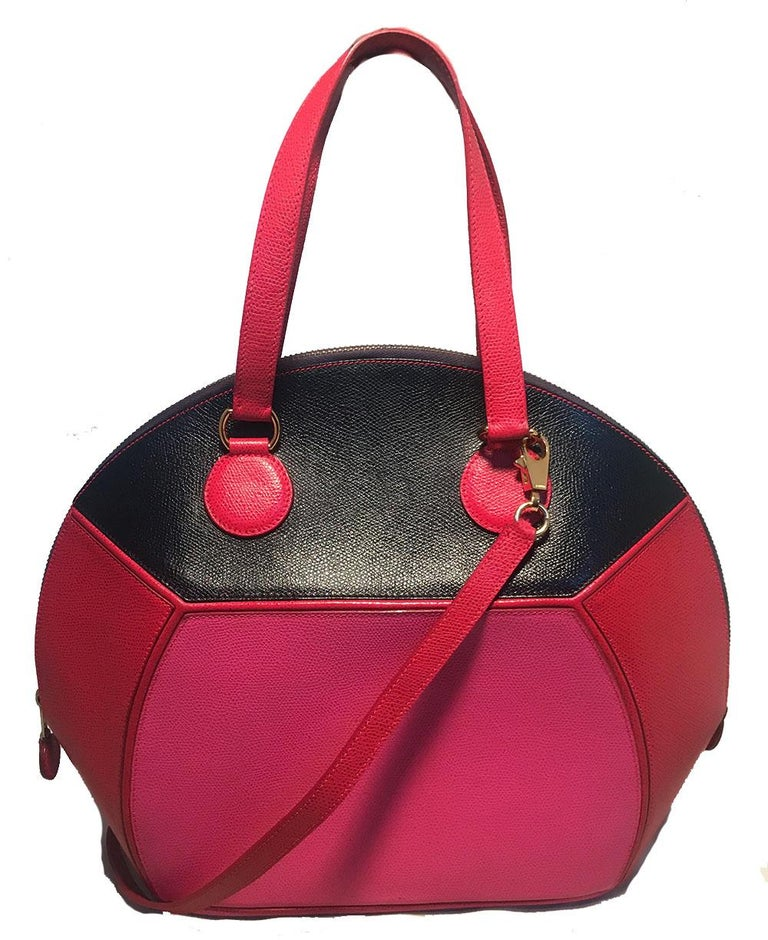 RARE Hermes Vintage Pink Red Black Color Block Epsom Round Ellipse Handbag in excellent condition. Red, pink, and black epsom leather exterior with gold hardware, double leather handles, and a removable red leather shoulder strap. Top zipper closure