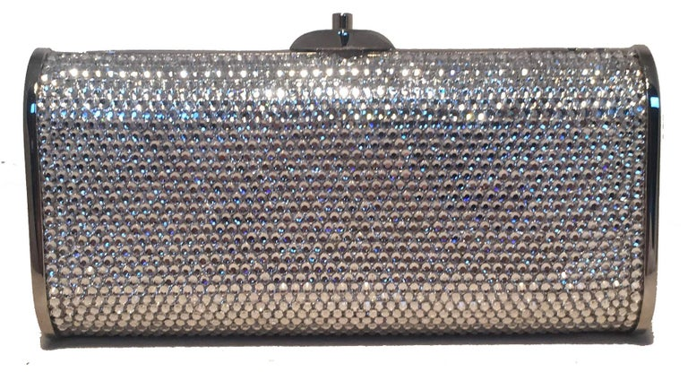 Judith Leiber Silver Clear Swarovski Crystal Minaudiere Evening Bag Clutch in excellent condition. Silver body, clear crystal exterior. Top button closure opens to a silver leather interior with a hidden attached chain shoulder strap. No stains,