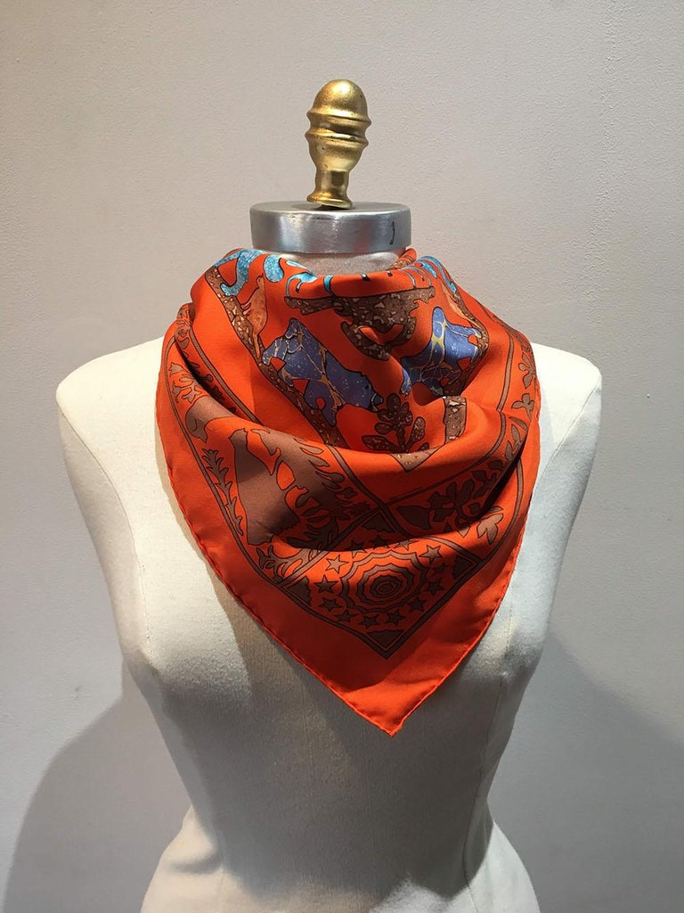 Hermes Early America Orange Silk Scarf in excellent condition. Original silk screen design c2012 by Francoise de la Perriere features an artistic rendition of Lady Washington and General George Washington in a center square surrounded by birds,