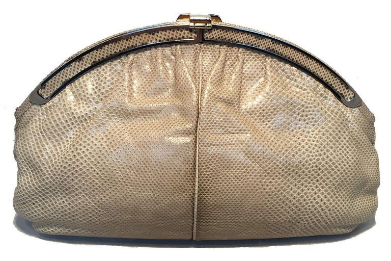 AMAZING Judith Leiber Vintage Beige Lizard Oversized Clutch in excellent condition. Natural beige lizard leather exterior trimmed with silver and gold hardware. Lift latch hinge closure opens to a light beige leather interior that holds one side