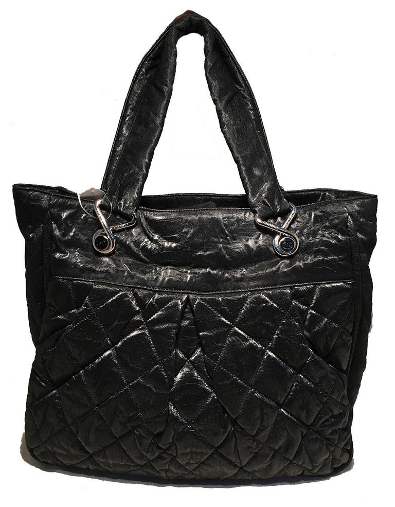 BEAUTIFUL Chanel Black Shimmery Soft Quilted Leather Tote Bag in very good condition. Black soft quilted shimmery leather exterior trimmed with silver hardware and two handles. Grey silk lined interior with plenty of space for all your belongings