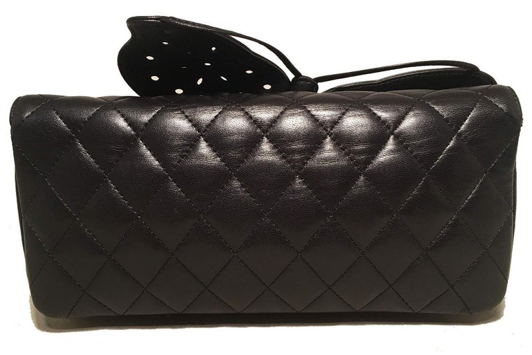 ADORABLE Chanel Quilted Black Leather Butterfly Classic Flap Shoulder Bag in excellent condition. Signature diamond quilted black lambskin leather exterior trimmed with silver hardware and a unique leather laser cut butterfly along the front flap.