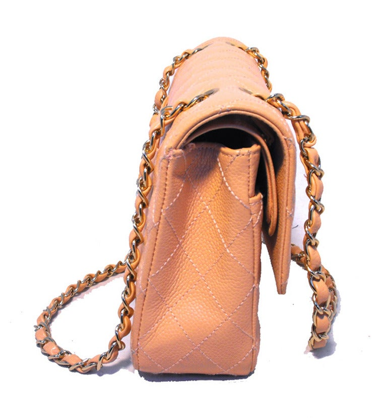 AMAZING Chanel peach caviar 2.55 double flap classic in excellent condition.  Quilted peach caviar leather exterior trimmed with shining gold hardware. Double flap style twist CC logo closure opens to a matching peach leather lined interior with 3