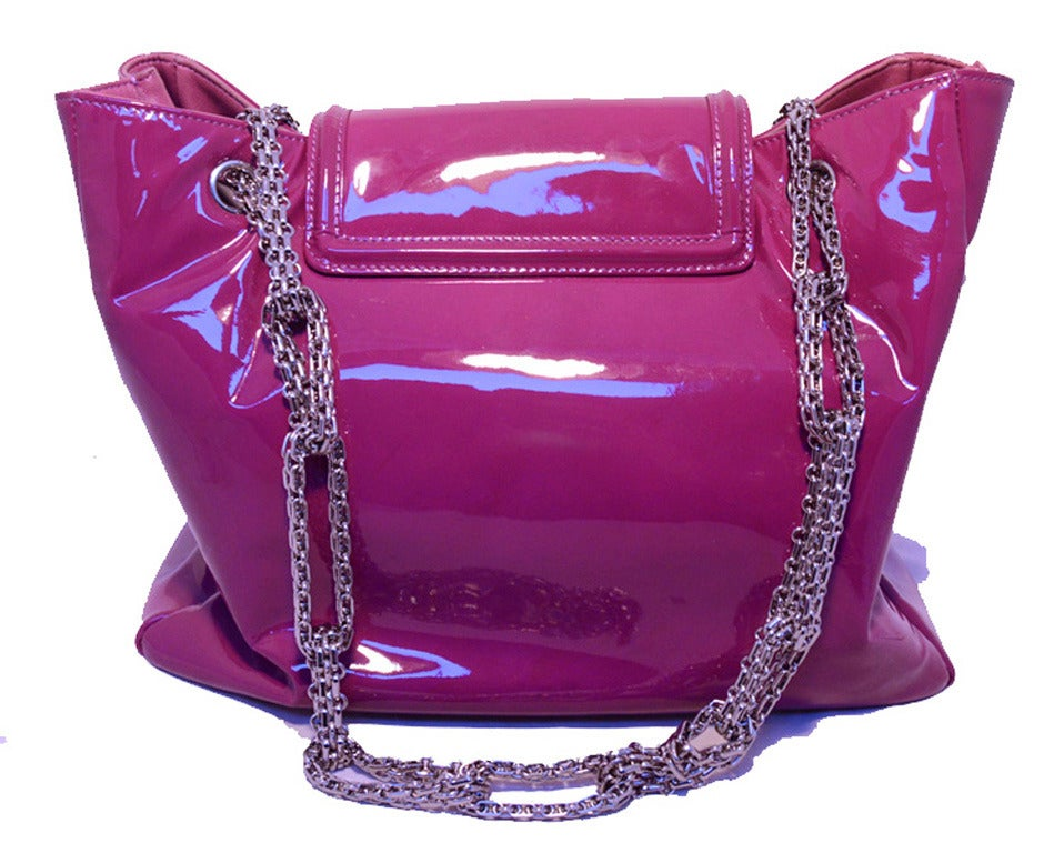 FABULOUS CHANEL Purple patent leather shoulder bag tote in excellent condition.  Gorgeous purple patent leather exterior trimmed with shining silver hardware.  Mademoiselle style twist flap closure opens to a grey satin lined interior that holds 1