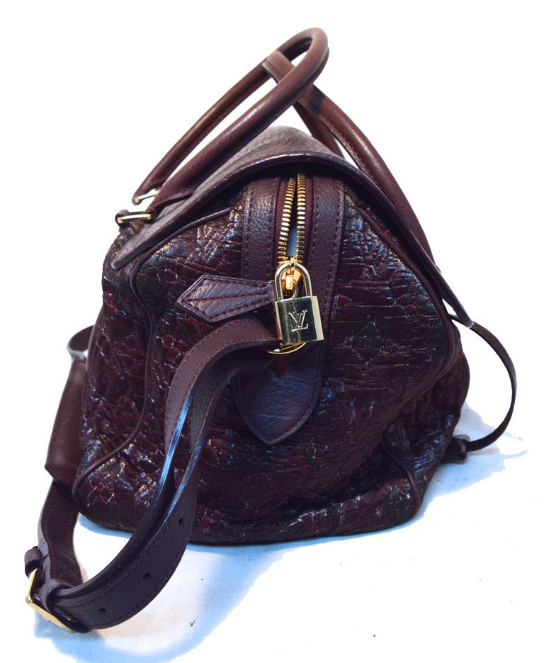 RARE LIMITED EDITION LOUIS VUITTON monogram volupte Psyche bag in excellent condition.  Purple cowhide leather with monogram coated cotton jacquard body and gold hardware.  Pinch style single flap closure opens to a black woven interior that holds