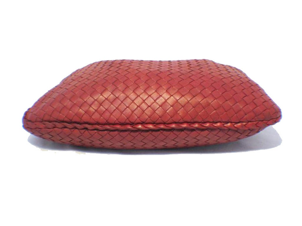 This amazing vintage Bottega Veneta bag is in excellent vintage condition.  The exterior features the classic Bottega woven leather style in red completed with a full top zipper closure.  This bag was used for one runway show then minimally by one