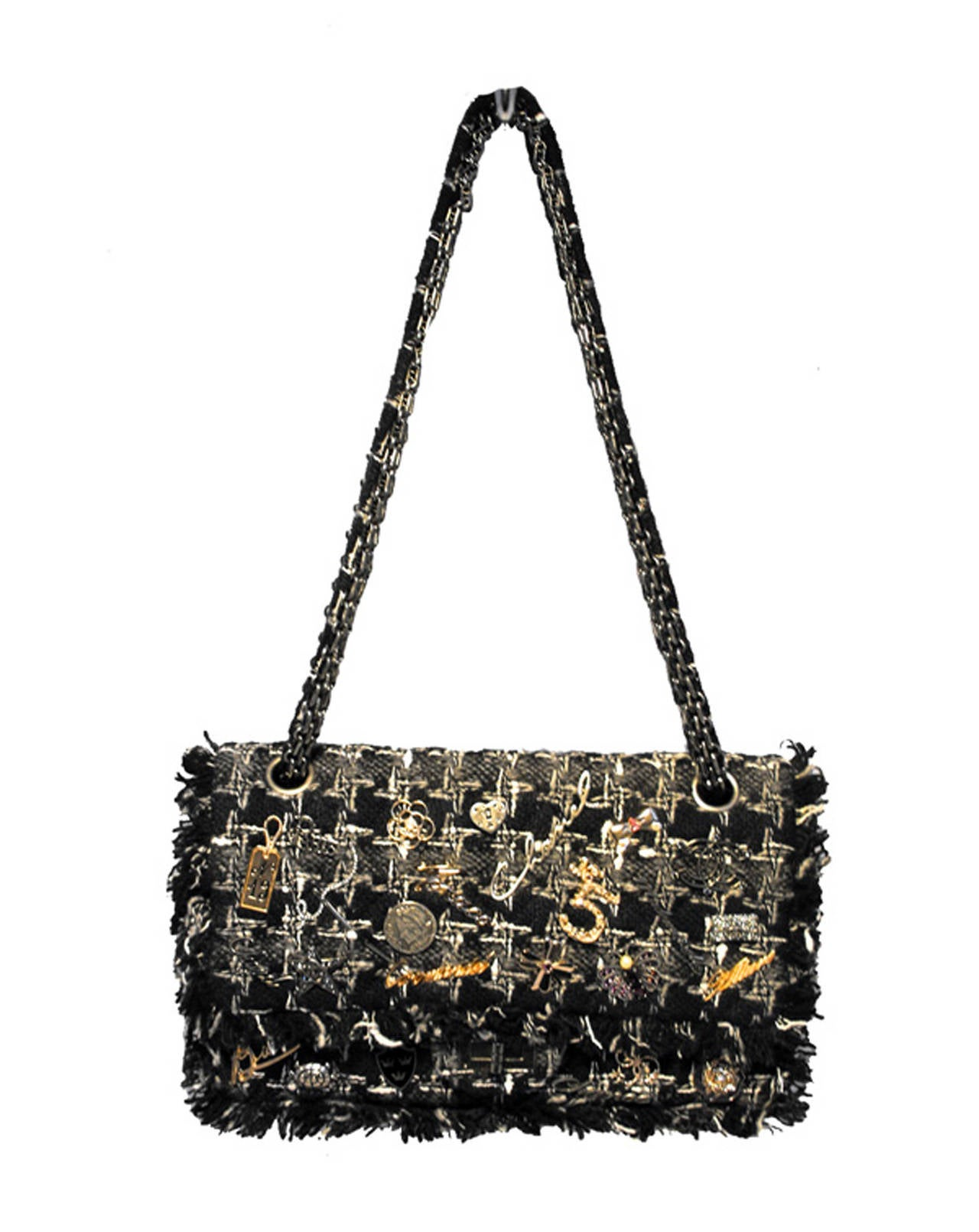 RARE CHANEL Charms classic 10inch 2.55 double flap in EXCELLENT condition.  Black, grey, white woven tweed exterior trimmed with rare Chanel charms on the front side.  Mademoiselle style twist closure opens double flap style to a black leather lined