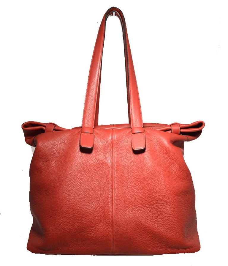 Authentic Hermes extra large shoulder bag Travel tote in very good condition. Soft Rouge red clemence leather exterior.  Double shoulder straps for comfortably carrying all your belongings in style.  Unique double tucked strap top closures that fold