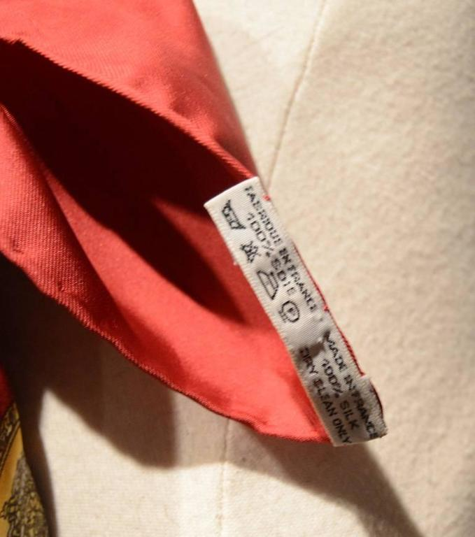 Authentic Hermes silk les tambours scarf in excellent condition.  Original silk screen design by Joachim Metz c1980s features a selection of colorful drums over a cream silk background with a red border.  100% silk, hand rolled hem, made in france.