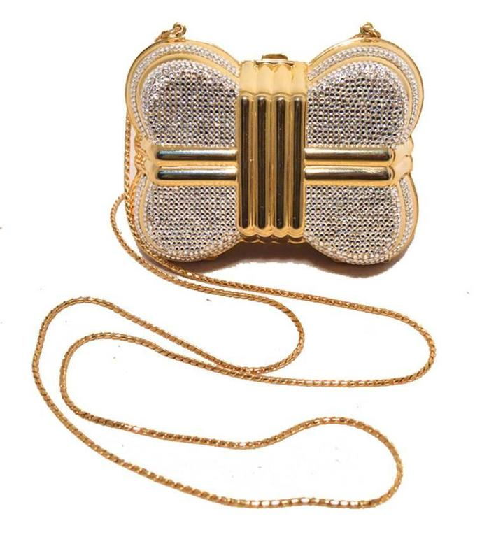 BEAUTIFUL JUDITH LEIBER Swarovski crystal casket minaudiere in excellent vintage condition.  Gold exterior trimmed with clear swarovski crystals in the signature