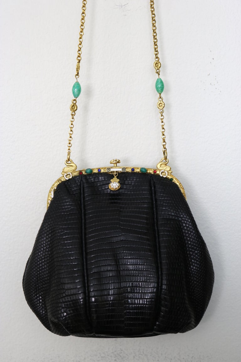 Gorgeous and Rare black lizard Jeweled Evening Bag designed with a circa 1925 24 Karat Gold plate Art Nouveau Frame with a pair of beautiful 24 K gold-plate Swan rings holding the chain on top of the bag. Truly a work of art!  The frame has enamel
