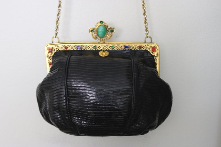 Gorgeous updated for today- lizard black Jeweled Evening Bag designed with a circa 1925 -22 Karat Gold plate Art Nouveau/Art Deco Period Frame with a large floral gold plate surrounded Turquoise Faux Gem Cabochon clasp on top. The frame is