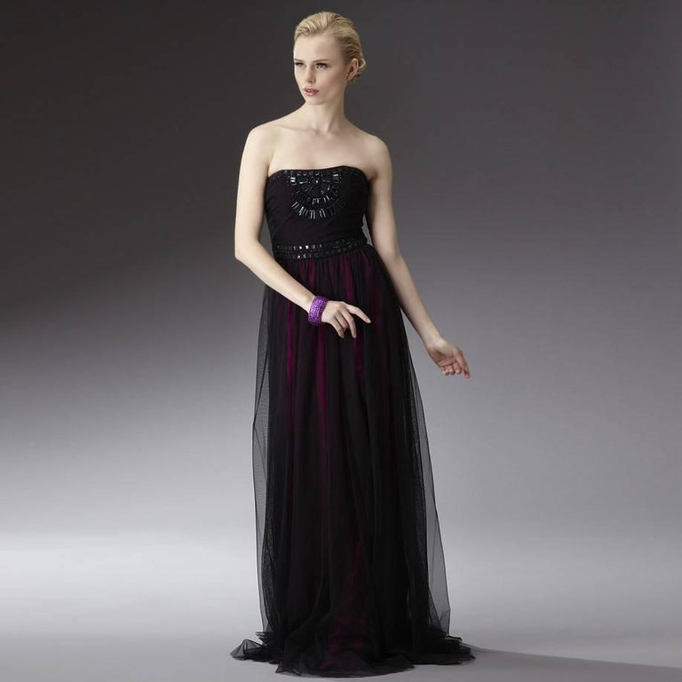 Badgley Mischka Gown Brand New with Tags Size: 4 100% Black Nylon Overlay 100% Silk Fuchsia Shell  Fuchsia Silk & Black Nylon Overlay Dress Fuchsia Silk Shell Shows Through the black Nylon for a Beautiful Color  Zipper and Hook Closure Beading at