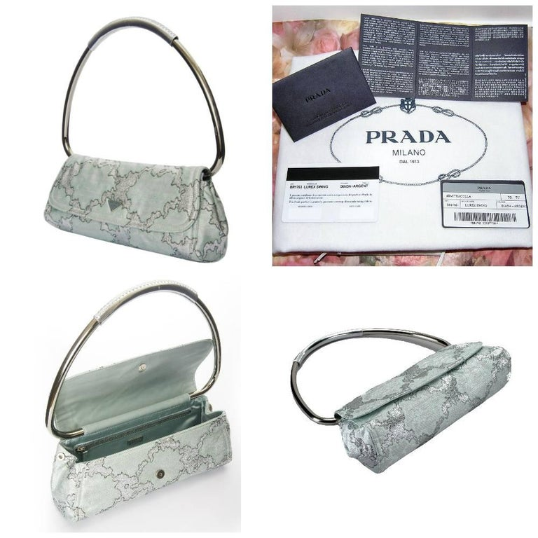 Rare Prada Lurex Bag Brand New $2950 * Stunning Lurex threading * Mint & Silver * Tube shape metal strap with leather corset details * Mint Satin Lining * Side prada snaps open to extend the size of the bag * 12