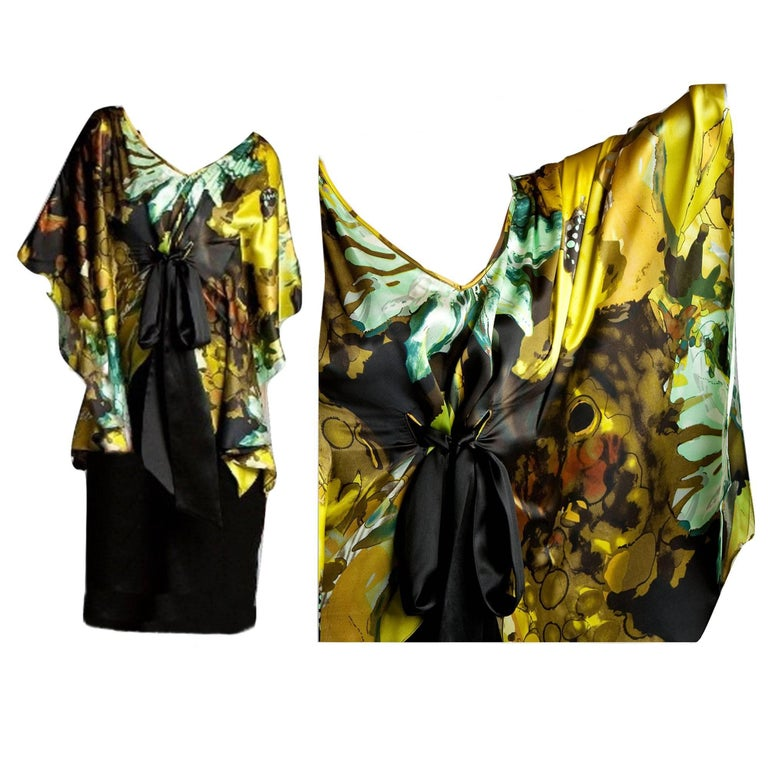 Badgley Mischka Dress Brand New with Tags Soft Silk Dress with a printed abstract flower pattern  poncho style top and black silk layer beneath Black Silk tunnel tie at front Top is 100% Silk  Slip is 100% Silk We are happy to provide measurements
