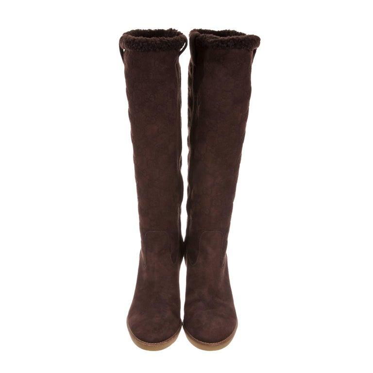 Gucci Shearling Boots RARE & Brand New! * Chocolate Color Shearling * U.S. Size: 10 * Super Soft Suede Merino Lambskin Shearling * GG Logo Throughout Shearling! * 1