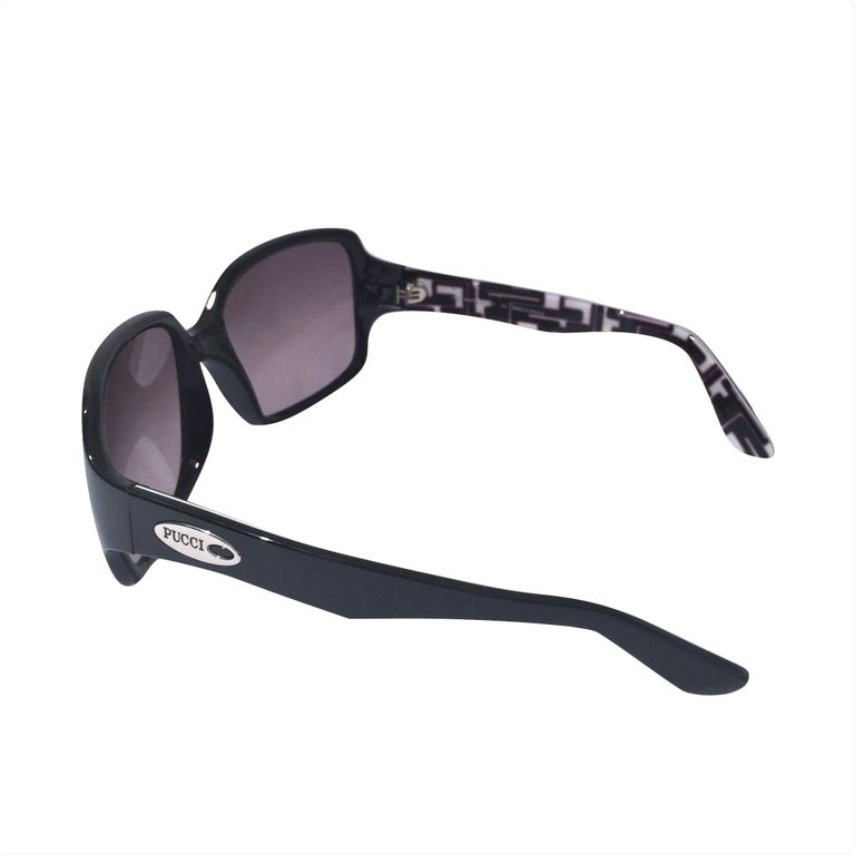 Emilio Pucci Sunglasses Brand New * Stunning Classic Pucci Sunglasses * Classic Black Frames * Pucci Print Interior: * Black, White & Pale Pink * Silver Pucci Logo on Both Sides * Handmade ZYL in Italy * 100% UV Protection * Comes with Case,