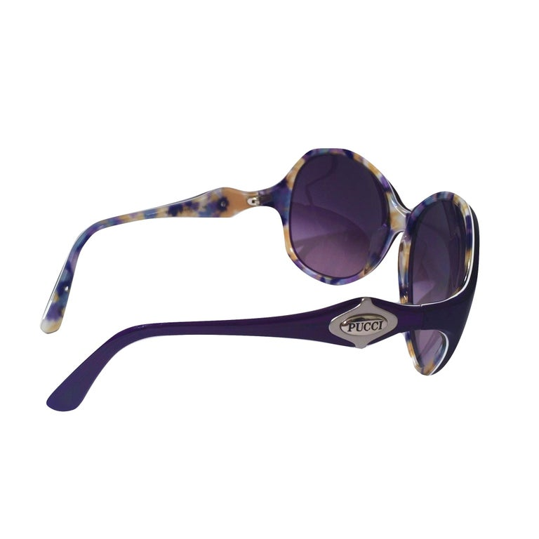 Emilio Pucci Sunglasses Brand New * Stunning Classic Pucci Sunglasses * Purple Frames * Pucci Print Interior: * Purple, Cream, Blue & Yellow * Silver Pucci Logo on Both Sides * Handmade ZYL in Italy * 100% UV Protection * Comes with Case, Cleaning