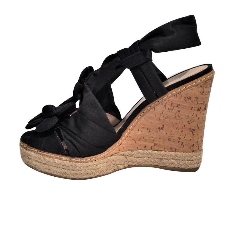 Prada Wedge Espadrilles  Excellent Condition! Worn Once! *Beautiful Prada Wedge Heels *Black Nylon Fabric *Flower Detail *Leather Insole *4.5