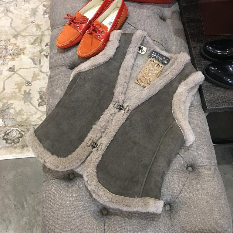 Da-Nang Shearling Vest Brand New w/ Tags * 100% Shearling Size: Small * Smooth Grey Shearling Exterior * Thick Shearling *  A Beautiful Grey * Incredibly Warm * Vintage Hook & Eye Closure