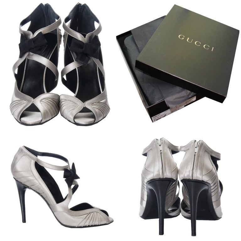 Tom Ford For Gucci Heels Brand New As Seen on Sarah Jessica Parker * Stunning in Silver Satin * Tom Ford for Gucci * Size: 8.5 * Black Satin Bow at Front * Leather Insole  * Zips up the Back  * 4