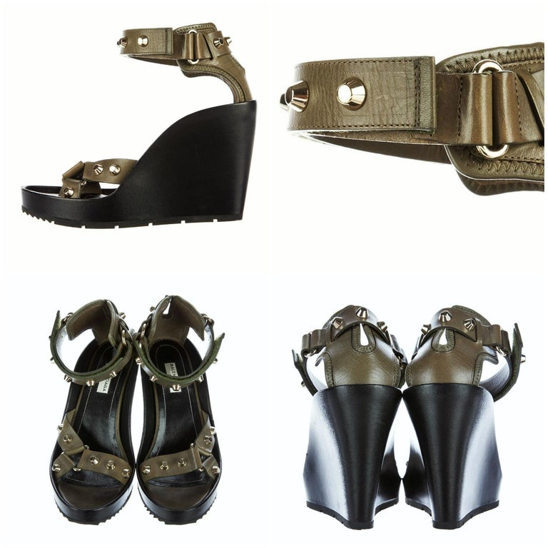 Balenciaga Wedge Platforms Brand New * Stunning in Olive & Black * Size: 37.5 * Adjustable Ankle Strap * Velcro Closure * Gold Studs * 1.25