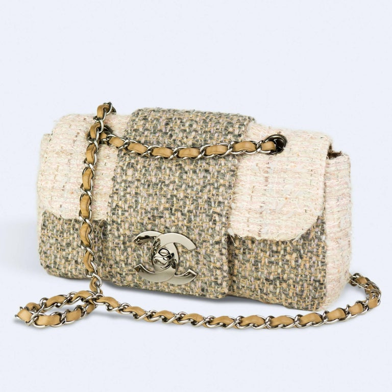 Chanel small cream and grey and multi color tweed with large CC logo and interlocking clasp  2004  {VINTAGE 14 Years} Antique silver hardware Interwoven chain Interior center pocket Interior brown lambskin lining on flap Interior brown nylon