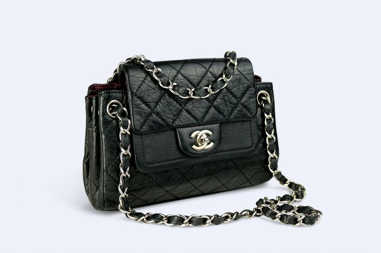 Chanel Calfskin Distressed Classic Limited Edition Double Flap Bag  2006 {VINTAGE 12 Years} Distressed quilted calfskin leather Double layer flap closure  Silver hardware Classic interowoven calfskin leather chain CC turnlock Burgundy lambskin