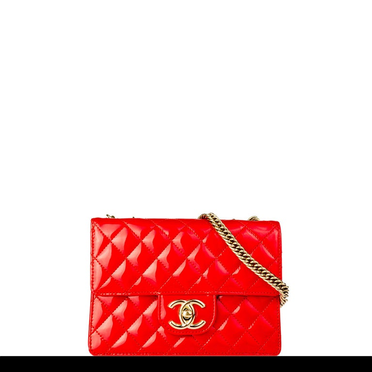 "Small Chanel red patent leather quilted sparkle flap.  2005 {VINTAGE 13 Years} Gold hardware Bijoux chain Red lambskin lined interior One small interior pocket Strap Drop: Single 7"" Double 13"" 4.25"" H x 6.75"" W x 3"" D Made in Italy Condition: Very"