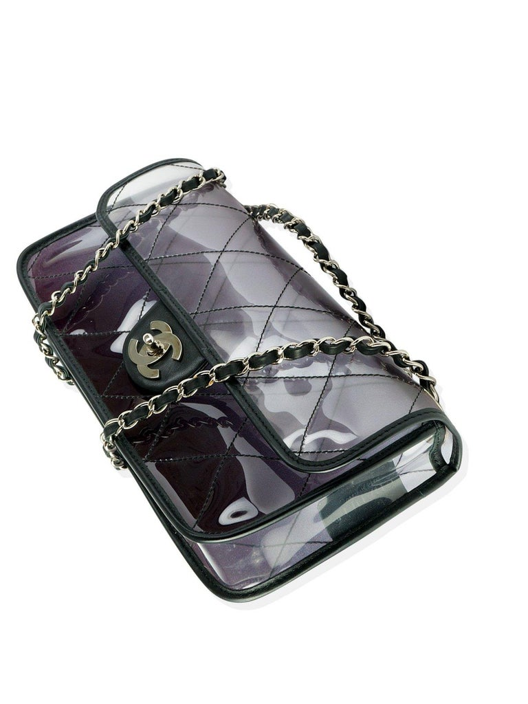 Chanel ombre smoke effect faded black and clear transparent vinyl flap with lamb leather.  Larger than a medium flap bag, featuring silver hardware and classic interwoven lambskin chain and CC turn lock closure.   In very good condition.   7