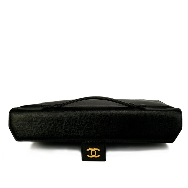 """Chanel unisex vintage large caviar briefcase with gold CC clasp  1997 {VINTAGE 24 Years} Gold hardware Two main interior compartments Interior centered zippered pocket 4 Bottom Protector Feet 10"""" H x 14.5"""" W x 3"""" D Handle Drop 4"""