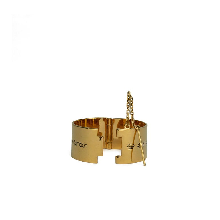 Chanel 31 Rue Cambon Cuff  Circa 1990s {VINTAGE 20 Years} Gold plated  31 Rue Cambon Address & Telex Engraved  Pin closure 7.75