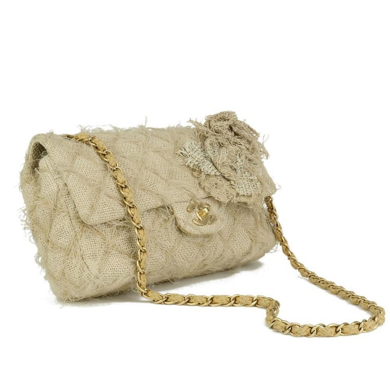 Chanel Spring/ Summer 2010 Runway Classic Flap Straw Camelia Rope Classic Flap Bag  Nude straw flap shoulder bag from Chanel featuring foldover top with twist-lock closure, a gold-tone logo plaque, a quilted effect, a chain shoulder strap, an