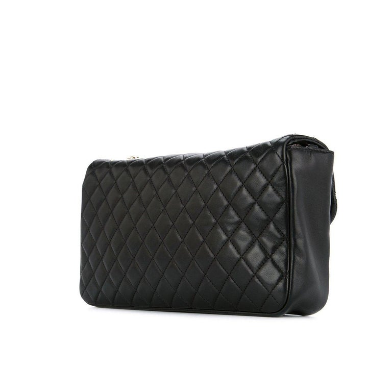 35108744f091 Diamond stitch Chanel quilted black lambskin flap with pearl CC logo and  pearl chain Year: