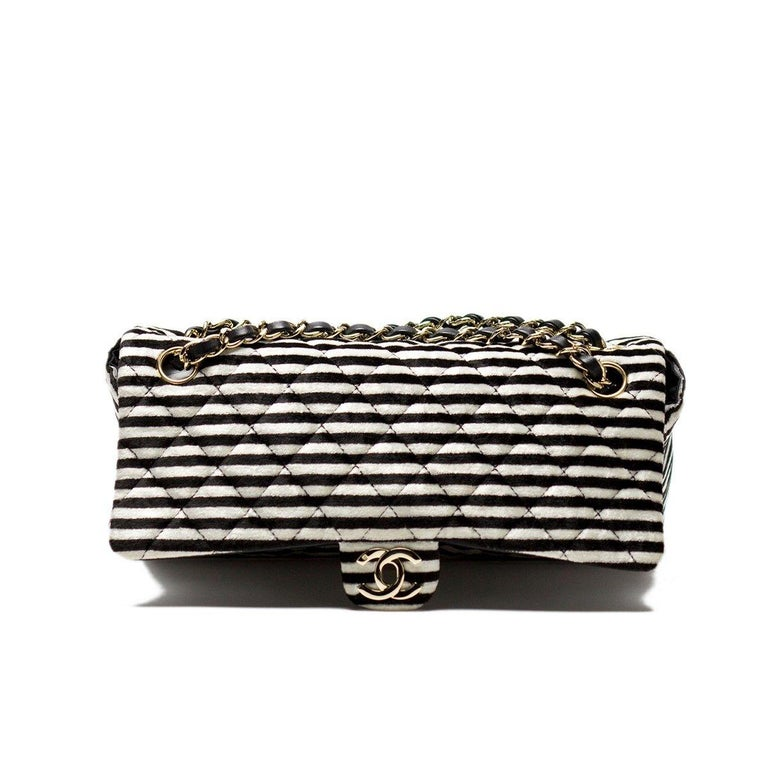 Chanel velour black and white striped flap  2006 {VINTAGE 12 Years} Silver Hardware Classic interwoven lambskin chain Three pearl charm detail on strap CC turnlock closure Black lambskin lined flap Nylon lined interior 6
