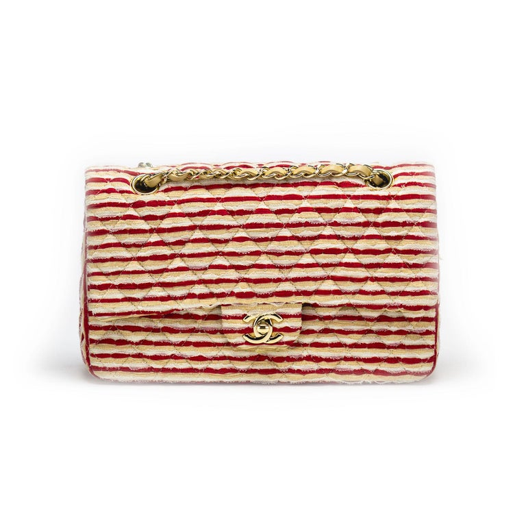 Red beige and white Chanel lambskin fabric double flap with interlocking cc clasp  2005 {VINTAGE 13 Years} Gold hardware Interior flap CC logo Interior zipper flap pocket Interior large front pocket Two interior small pockets Beige lambskin interior