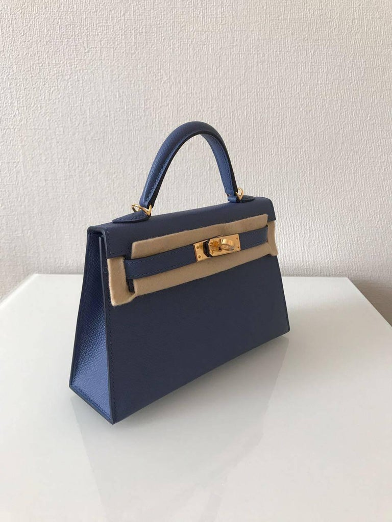 New never worn Hermes Bag Kelly Size 20 Leather Epsom Color Blue Brighton Gold hardware  Comes full set:  Original box Invoice Raincoat Padlock & Keys Dustbag