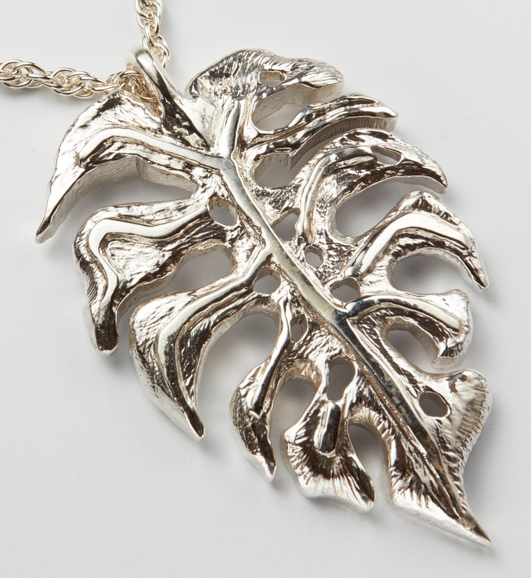 Large sterling silver monstera leaf pendant hand made by NYC artist Christopher Phelan. Diameter of leaf is 2 ½ x 1 ¾ Inches. Length of necklace 28 inches.