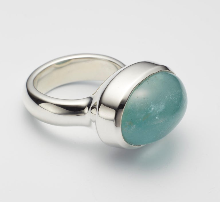 One of a kind aquamarine cabochon sterling silver ring, hand made by jeweler Christopher Phelan. Aquamarine cabochon size 20 x 15 millimeter. Width of band 5.6 millimeter. Ring size 6.