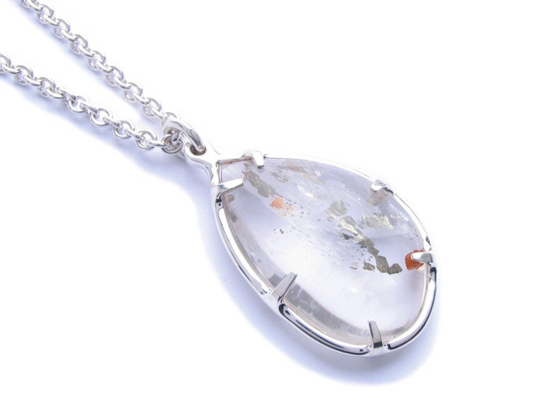 Christopher Phelan one of a kind pyrite quartz pendant set in sterling silver necklace. Diameter of pendant is 2 x 1 ½ Inches. Length of necklace 28 inches.