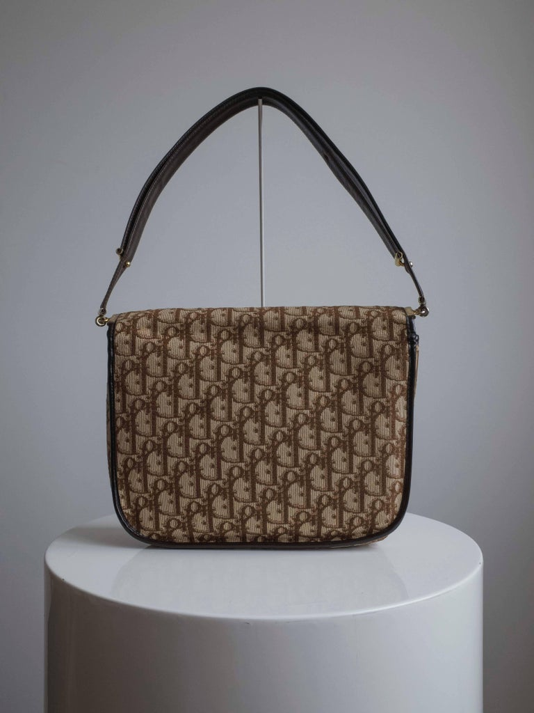 34e25063001f Vintage 1970s handbag by Christian Dior. Features Dior jacquard pattern in  canvas and deep burgundy