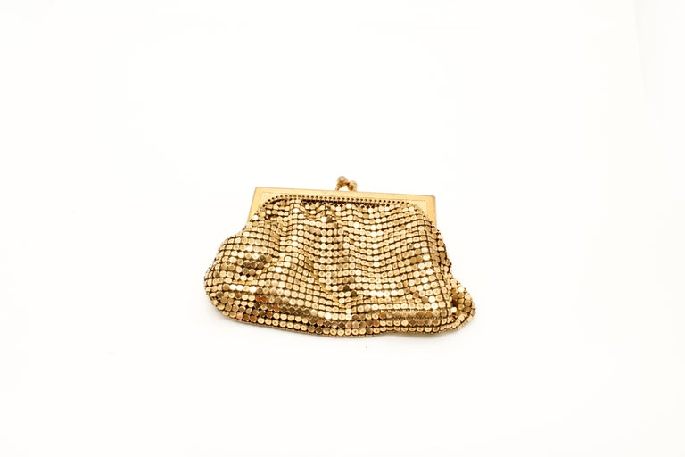 Whiting & Davis 1970s Vintage Gold Mesh Evening Purse.  Signed on inside of clasp.  A bit about the designer In 1892, Charles Whiting wove by hand the first Whiting & Davis handbag, transforming the ancient art of chainmail into a fabric.  Whiting &