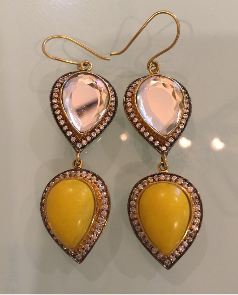 Light reflecting polki mirror stones & resin earrings is framed with sparkling cubic zircon. Earrings have a fish hook closure for pierced ears.  FOLLOW  MEGHNA JEWELS storefront to view the latest collection & exclusive pieces.  Meghna Jewels is