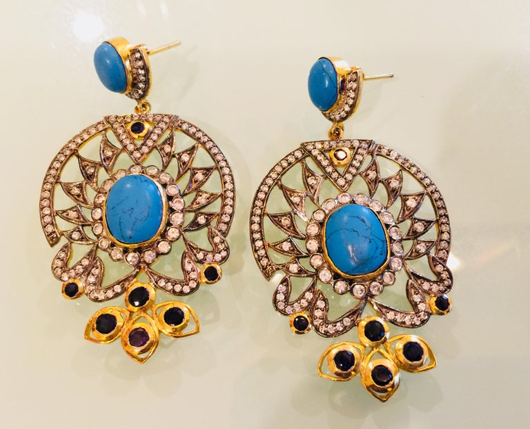 The design is ornate and lovely, the striking turquoise stone is enhanced by quartz stones and sparkling CZ stones. Earrings have a post closure for pierced ears.  A short video can be requested for this piece. Stone: Turquoise, quartz, cubic