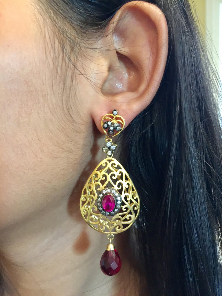 The handmade filigree faux ruby earrings is ornate and lovely, it is further enhanced by sparkling CZ stones. Earrings have a post closure for pierced ears.  Length: 2 3/4 inches Width: 1 1/2 inches  FOLLOW  MEGHNA JEWELS storefront to view the