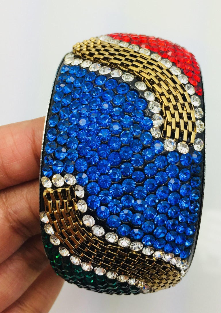 Stunning Slip On bracelet embellished with bright color red, blue, green and magenta crystals and rhinestone. Further enhanced with gold chain. Only 1 available.  Inner diameter 65.00 mm (2.56 in), inner circumference 204.2 mm (7.04 in)  A short